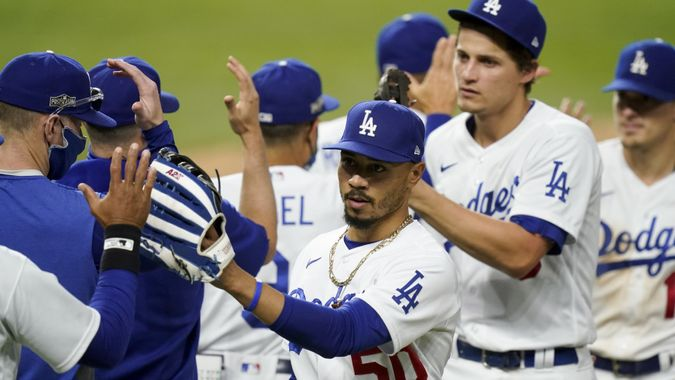 Photo by Eric Gay/AP/Shutterstock (10963350bo)Los Angeles Dodgers right fielder Mookie Betts celebrates their win in Game 6 of a baseball National League Championship Series against the Atlanta Braves, in Arlington, TexasNLCS Braves Dodgers Baseball, Arlington, United States - 17 Oct 2020.
