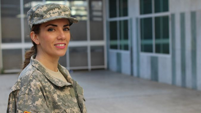 Military female smiling - Stock image with copy space.