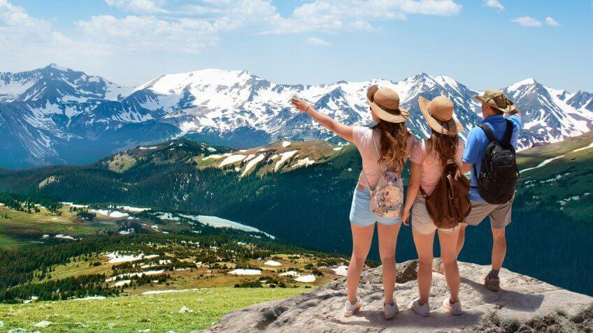 Family enjoying  beautiful view in the mountains.