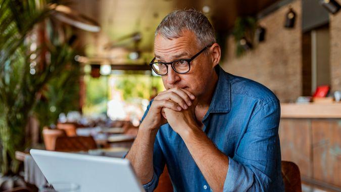 Contemplating businessman in the restaurant feeling sad.