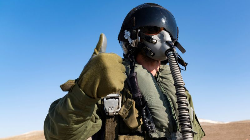 Pilot with suit and military air.