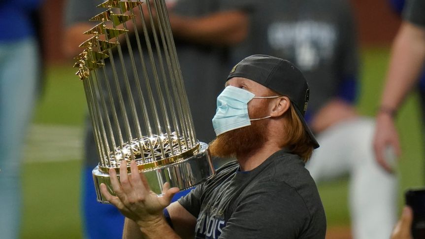 Mandatory Credit: Photo by Eric Gay/AP/Shutterstock (10996083a)Los Angeles Dodgers third baseman Justin Turner celebrates with the trophy after defeating the Tampa Bay Rays 3-1 to win the baseball World Series in Game 6 in Arlington, Texas.