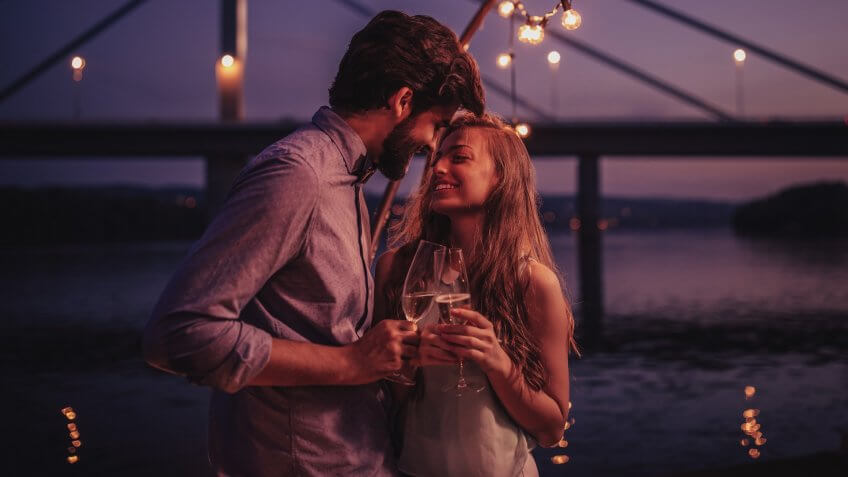 Couple having some special moments at boat party