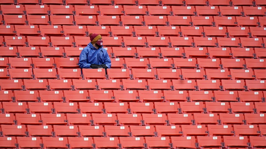 Mandatory Credit: Photo by Patrick Semansky/AP/Shutterstock (10974212q)Fans sits in an empty seating section of Fedex Field during the first half of an NFL football game between Dallas Cowboys and Washington Football Team, in Landover, MdCowboys Washington Football, Landover, United States - 25 Oct 2020.