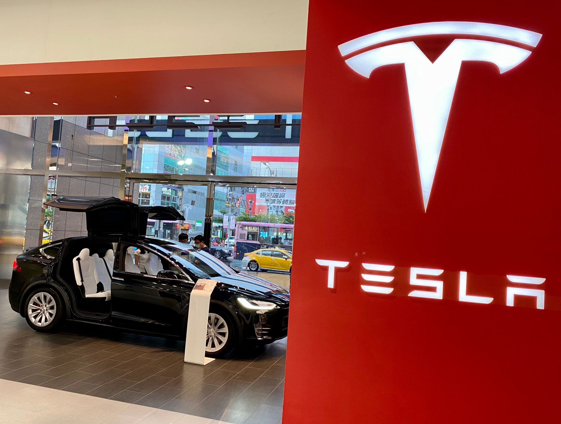 Mandatory Credit: Photo by RITCHIE B TONGO/EPA-EFE/Shutterstock (10724187c)People check the interior of Tesla Model X car on display inside a Tesla showroom in Taipei, Taiwan, 27 July 2020.