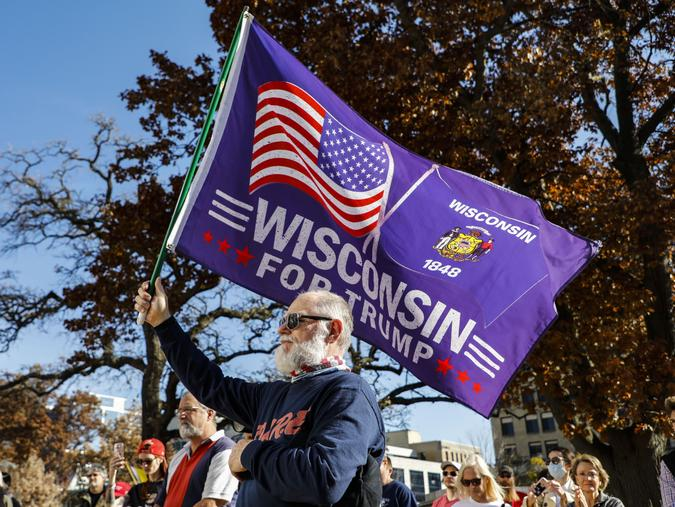Mandatory Credit: Photo by CHINE NOUVELLE/SIPA/Shutterstock (11007653m)A supporter of Donald Trump holds a flag at a rally in Madison, Wisconsin, the United States, on Nov.
