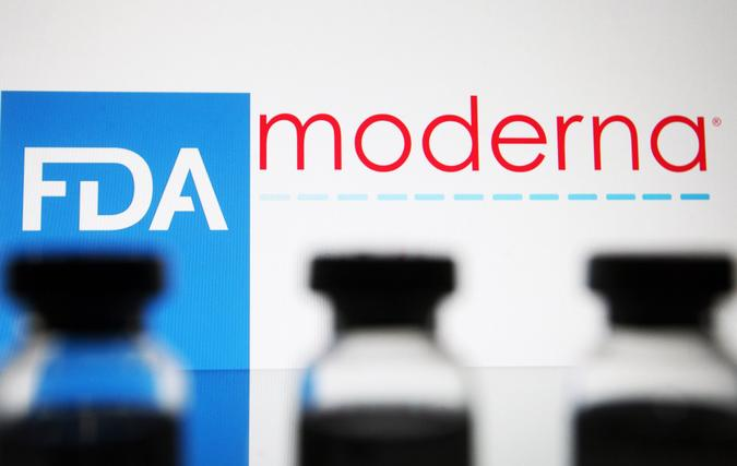 Mandatory Credit: Photo by Pavlo Gonchar/SOPA Images/Shutterstock (11554233a)In this photo illustration, vials seen displayed in front of the Food and Drug Administration (FDA) of the United States and Moderna biotechnology company's logos.