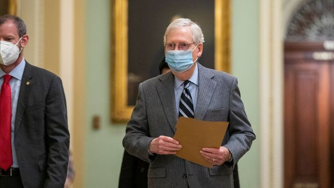 Mandatory Credit: Photo by SHAWN THEW/EPA-EFE/Shutterstock (11559659e)Senate Majority Leader Mitch McConnell walks to the Senate Floor in the US Capitol in Washington, DC, USA, 16 December 2020.