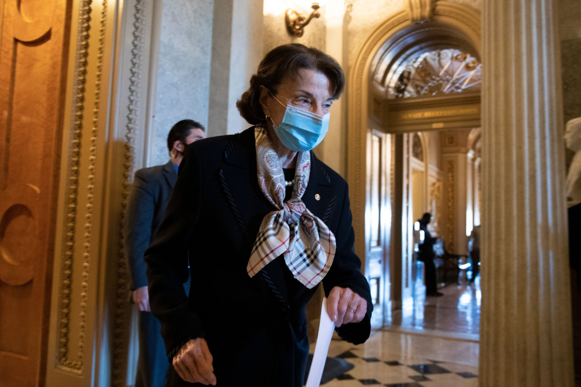Mandatory Credit: Photo by MICHAEL REYNOLDS/EPA-EFE/Shutterstock (11574686r)Democratic Senator from California Dianne Feinstein walks from the Senate floor on Capitol Hill in Washington, DC, USA, 17 December 2020.