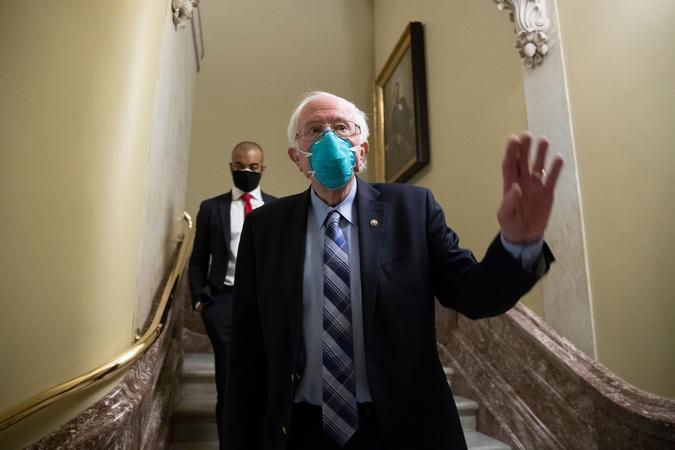 Mandatory Credit: Photo by MICHAEL REYNOLDS/EPA-EFE/Shutterstock (11650752g)Independent Senator from Vermont Bernie Sanders walks from the Senate floor during votes on Capitol Hill in Washington, DC, USA, 20 December 2020.