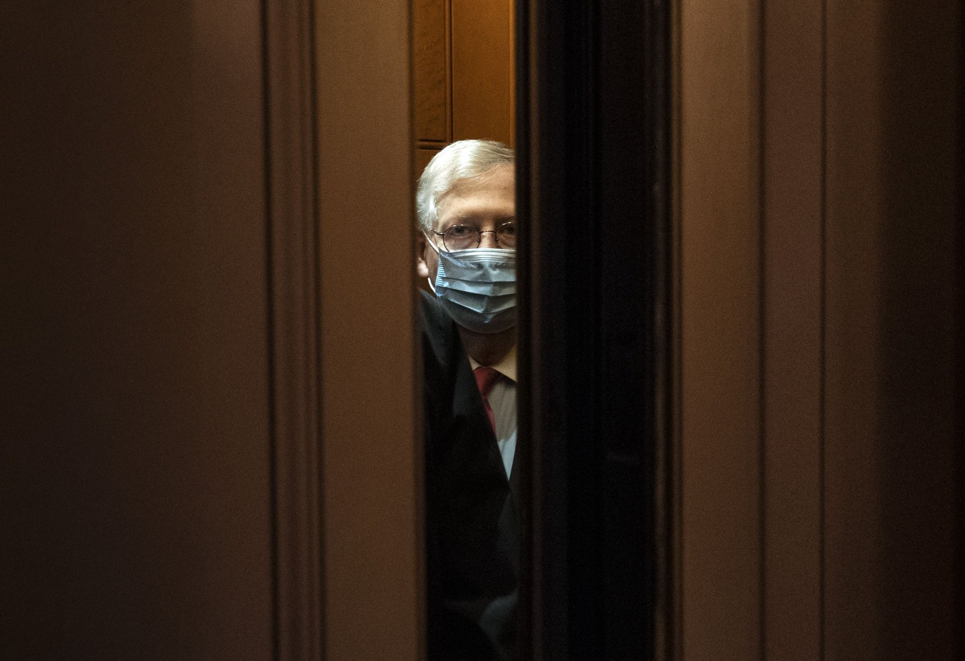Mandatory Credit: Photo by Kevin Dietsch/UPI/Shutterstock (11664327e)Senate Majority Leader Mitch McConnell, R-KY, takes an elevator as he leaves his office at the U.