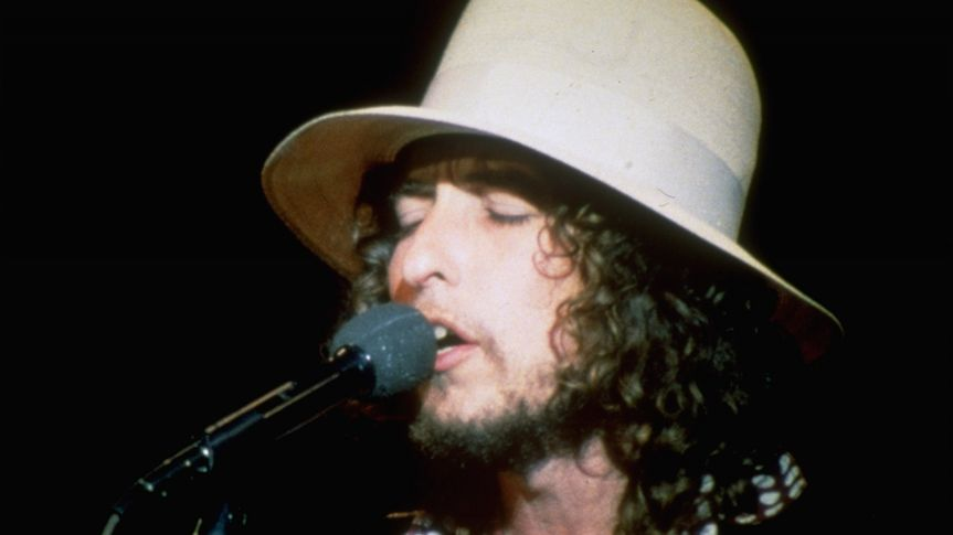 """Mandatory Credit: Photo by AP/Shutterstock (6588803a)Dylan, Bob Folk singer Bob Dylan sings on stage during his final appearance with """"The Band"""" at the Winterland Ballroom in San Francisco, Calif."""