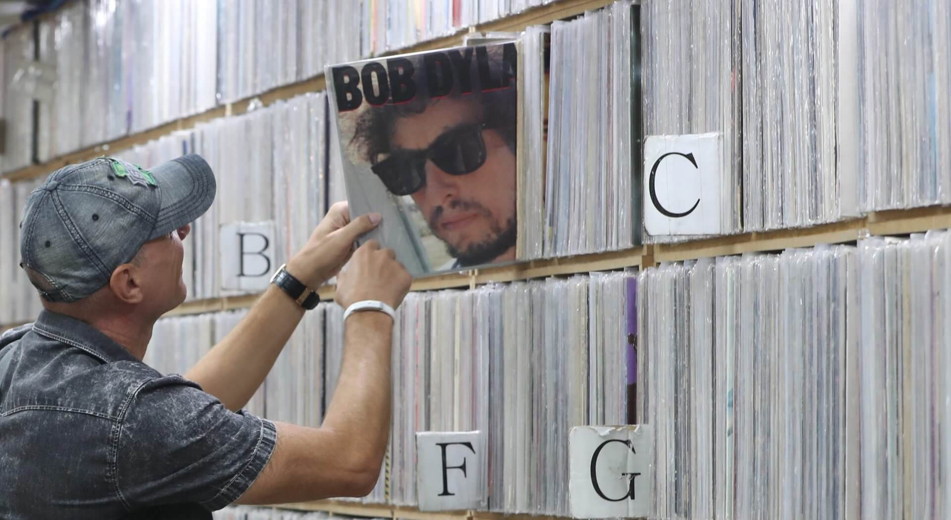 Mandatory Credit: Photo by Yonhap/EPA/Shutterstock (8368141a)A Customer Looks at a Bob Dylan Album at a Record Shop in Seoul South Korea 14 October 2016 Dylan's 'Knockin' on Heaven's Door' Placed Third on the Top 100 Chart For Foreign Songs on the Nation's Largest Portal Naver when the News of the Us Singer-songwriter Winning the Nobel Literature Prize Hit the Nation Korea, Republic of SeoulSouth Korea Music Bob Dylan - Oct 2016.