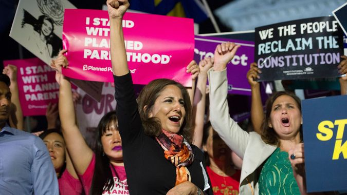 Mandatory Credit: Photo by Cliff Owen/AP/Shutterstock (9747935d)Neera Tanden, president, Center for American Progress, center, rallies in front of the Supreme Court in Washington, after President Donald Trump announced Judge Brett Kavanaugh as his Supreme Court nomineeTrump Supreme Court, Washington, USA - 09 Jul 2018.