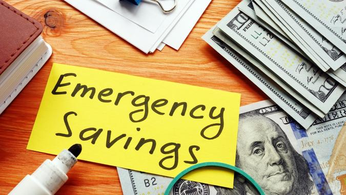 Emergency savings memo and stack of money.