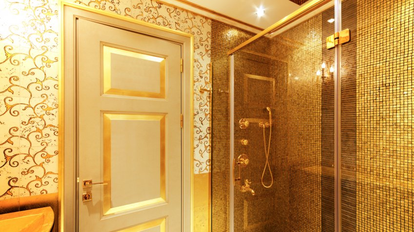 Luxurious golden shower and door.