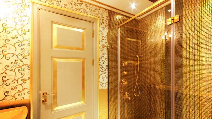 Luxurious golden shower and door.