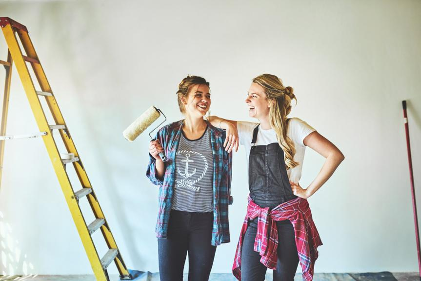 Shot of two young woman busy with renovations at home.