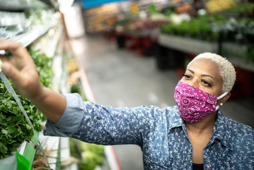 Woman with face mask shopping at supermarket.