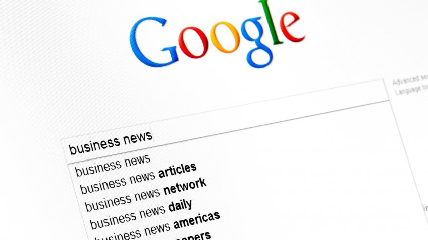 Kyiv, Ukraine - March 13, 2011: Business news text string in google search field start page.
