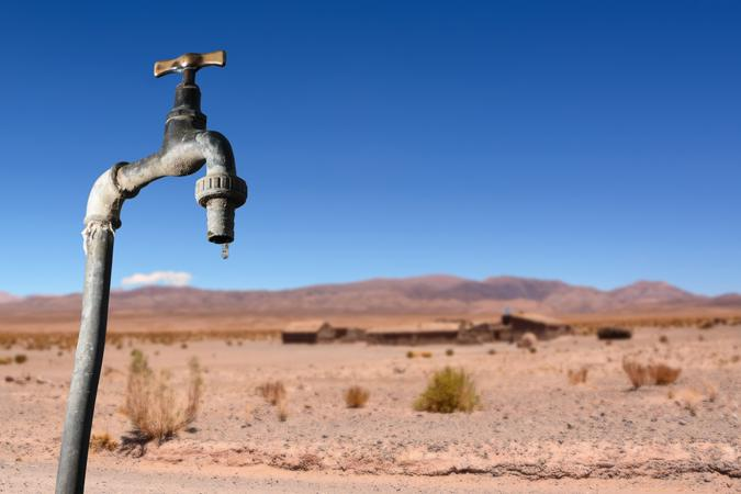 Drips faucet and dry environment in the background.
