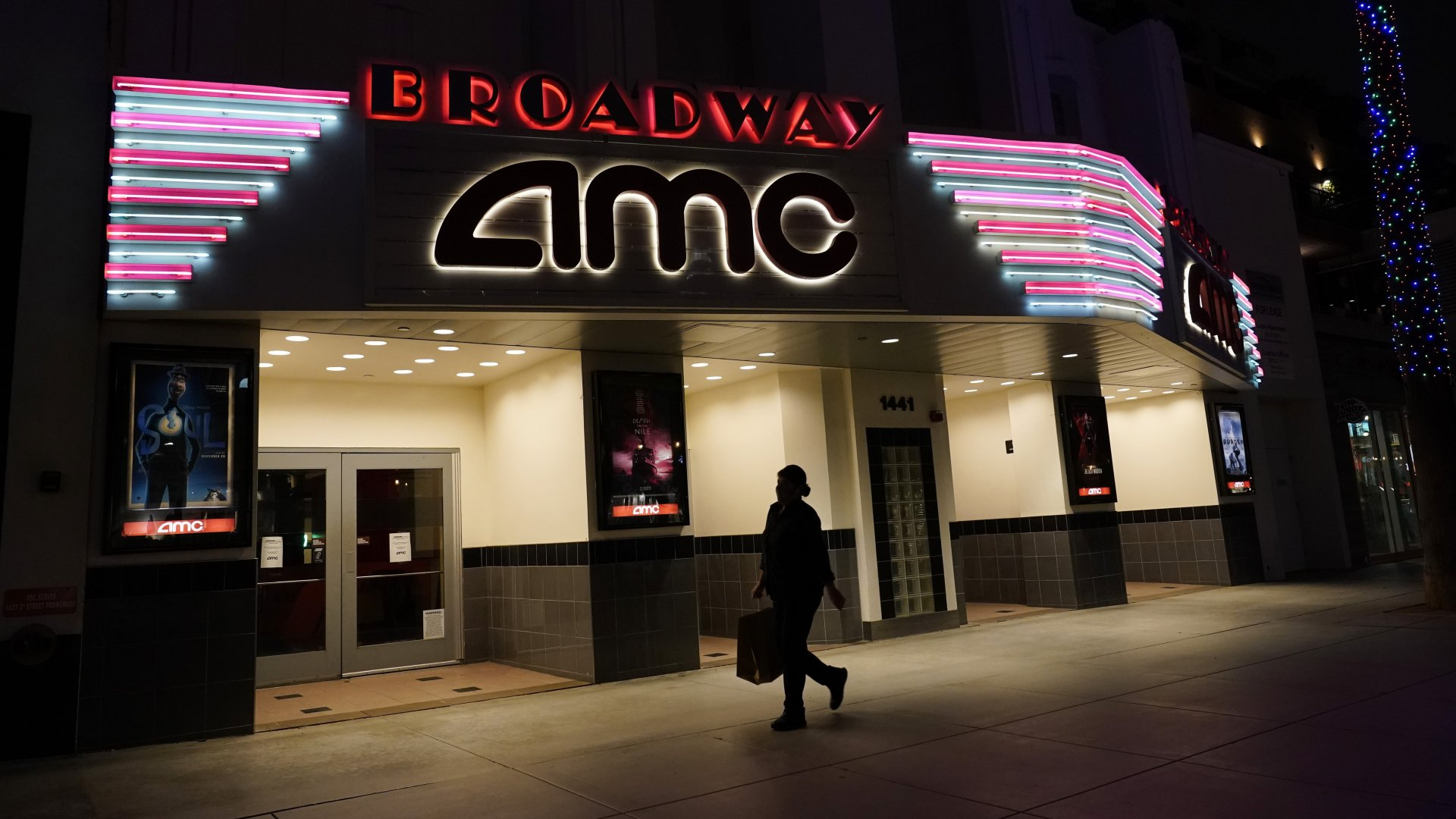 Mandatory Credit: Photo by Marcio Jose Sanchez/AP/Shutterstock (11034901a)A shopper walks past a closed AMC movie theater in Santa Monica, Calif.