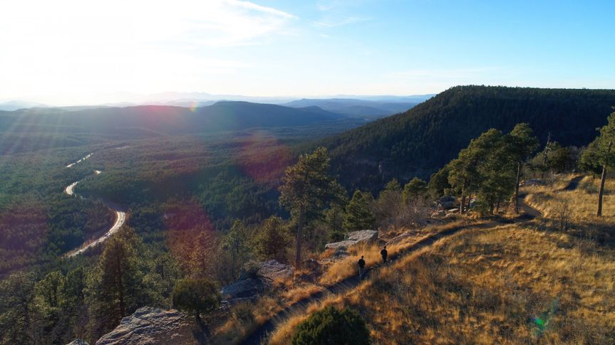 The highway snakes along at the bottom of the mogollon rim.