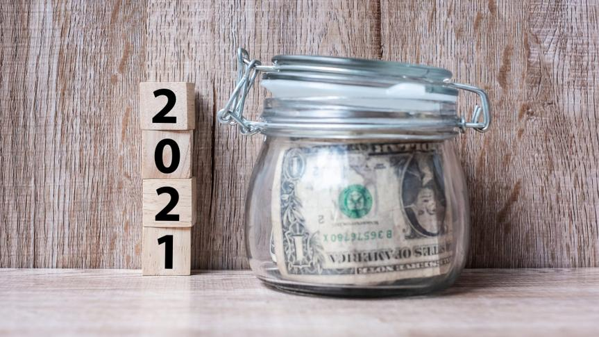 2021 Happy New Year with US dollar money glass American on wood table background.