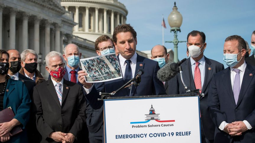 Mandatory Credit: Photo by Shutterstock (11121661y)United States Representative Dean Phillips (Democrat of Minnesota) holds up photos which he says are of people waiting in long lines to get free food, as he offers remarks while joined by members the Problem Solvers Caucus during a press conference on the need for bipartisan and bicameral COVID-19 relief, outside of the U.