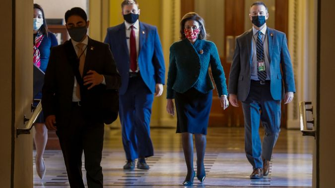 Mandatory Credit: Photo by SHAWN THEW/EPA-EFE/Shutterstock (11670628a)Speaker of the House Nancy Pelosi walks to her office from the House floor in the US Capitol in Washington, DC, USA, 28 December 2020.