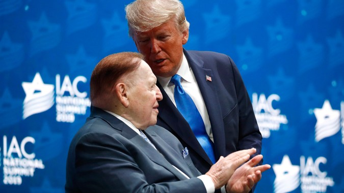 Mandatory Credit: Photo by Patrick Semansky/AP/Shutterstock (10494516m)President Donald Trump speaks with Las Vegas Sands Corporation Chief Executive and Republican mega donor Sheldon Adelson before speaking at the Israeli American Council National Summit in Hollywood, FlaTrump, Hollywood, USA - 07 Dec 2019.