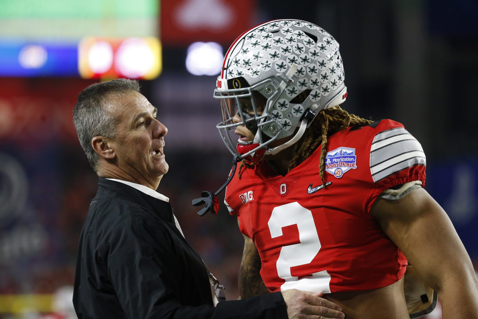 Mandatory Credit: Photo by Charles Baus/CSM/Shutterstock (10514187cr)Former Ohio State coach Urban Meyer with Ohio State Buckeyes defensive end Chase Young #2 during the Playstation Fiesta Bowl semifinal playoff game between the Ohio State Buckeyes and the Clemson Tigers at State Farm Stadium in Glendale, Arizona.