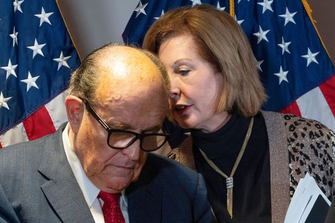 Mandatory Credit: Photo by Jacquelyn Martin/AP/Shutterstock (11024215h)Former Mayor of New York Rudy Giuliani, left, listens to Sidney Powell, both lawyers for President Donald Trump, during a news conference at the Republican National Committee headquarters, in WashingtonCongress Democrats, Washington, United States - 19 Nov 2020.