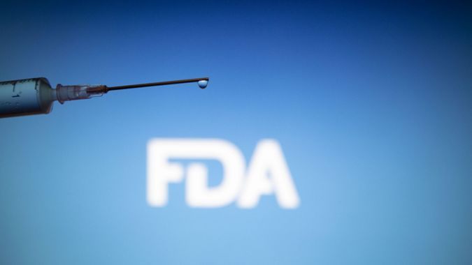 Mandatory Credit: Photo by Nik Oiko/SOPA Images/Shutterstock (11674427e)In this photo illustration a medical syringe is seen with FDA logo ( Food and Drug Administration of the United States )FDA approved Pfizer / BioNTech and Moderna COVID-19 coronavirus vaccine for emergency use in the US, with an emergency use authorization (EUA)Medical syringe illustrations in Netherlands - 30 Dec 2020.