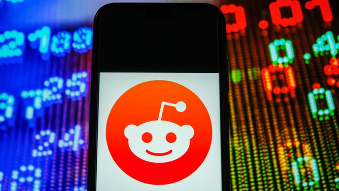 Mandatory Credit: Photo by Omar Marques/SOPA Images/Shutterstock (11683098aa)In this photo illustration, a Reddit logo seen displayed on a smartphone with stock market prices in the background.