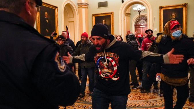 Mandatory Credit: Photo by Manuel Balce Ceneta/AP/Shutterstock (11694690h)Protesters gesture to U.