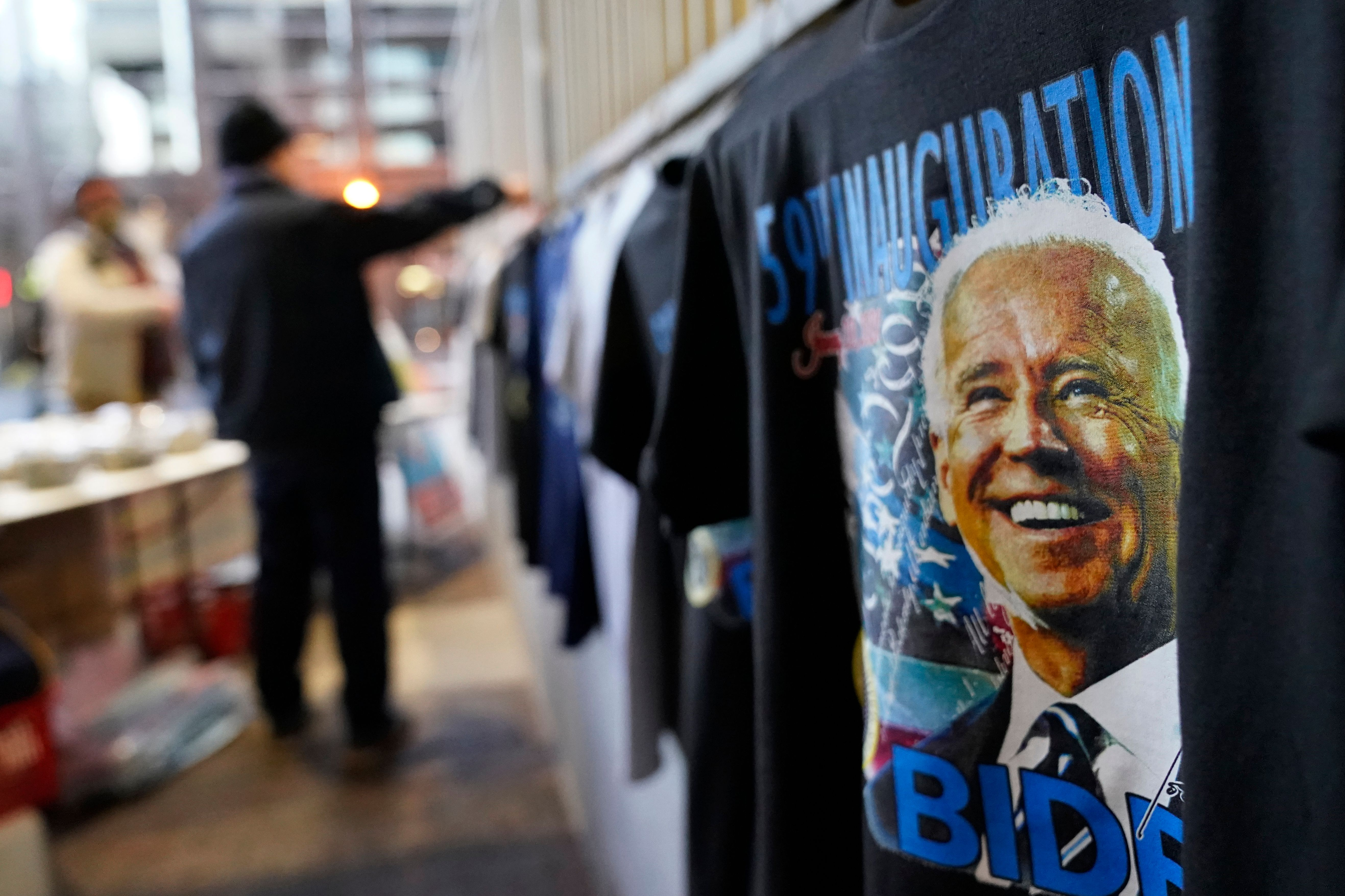 Mandatory Credit: Photo by David Goldman/AP/Shutterstock (11718139ah)Gi Chung sets up his souvenir stand with Joe Biden memorabilia ahead of President-elect Joe Biden's inauguration ceremony, in WashingtonBiden Inauguration Security, Washington, United States - 20 Jan 2021.