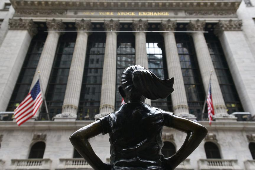 Mandatory Credit: Photo by Erik Pendzich/Shutterstock (11728929h)The Fearless Girl bronze sculpture by Kristen Visbal stands across from the New York Stock Exchange on Wall StreetCoronavirus outbreak, New York, USA - 27 Jan 2021.