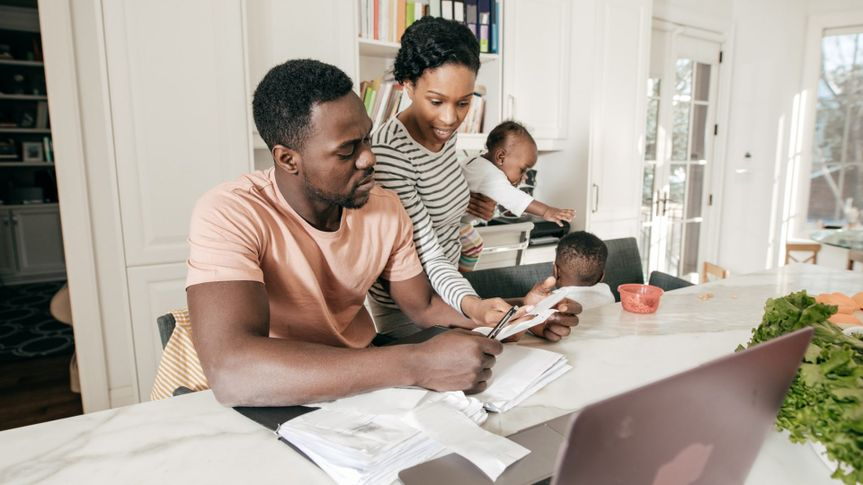 A couple is doing accounting at home.