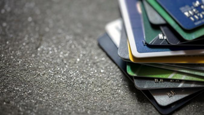 Credit cards heaped up background with copy space.