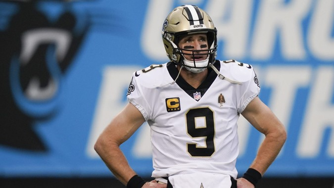 Mandatory Credit: Photo by Gerry Broome/AP/Shutterstock (11677866m)New Orleans Saints quarterback Drew Brees watches during warm ups before an NFL football game against the Carolina Panthers, in Charlotte, N.