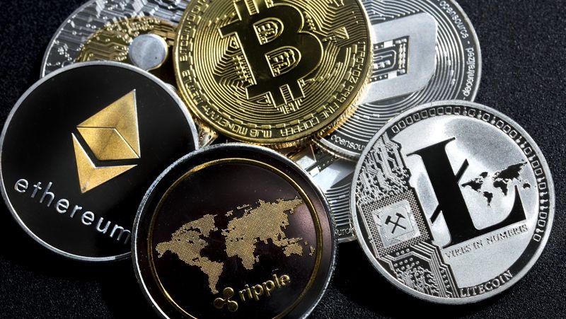 izmir, Turkey - September 28, 2018 Close up ethereum ripple litecoin bitcoin dash coins shot in metallic black background in studio.