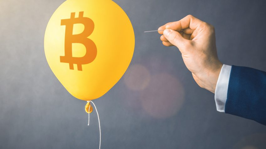 Bitcoin cryptocurrency symbol on yellow balloon.