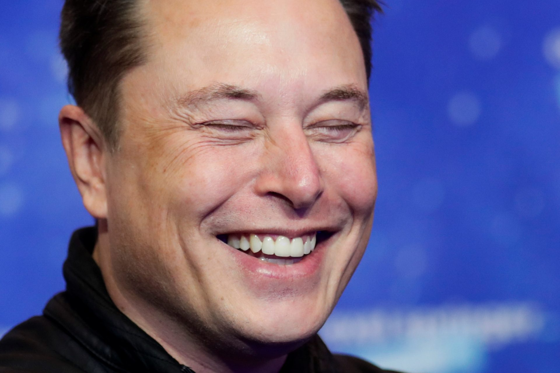 Mandatory Credit: Photo by HANNIBAL HANSCHKE/POOL/EPA-EFE/Shutterstock (11088622z)SpaceX owner and Tesla CEO Elon Musk laughs after arriving on the red carpet for the Axel Springer award, in Berlin, Germany, 01 December 2020.