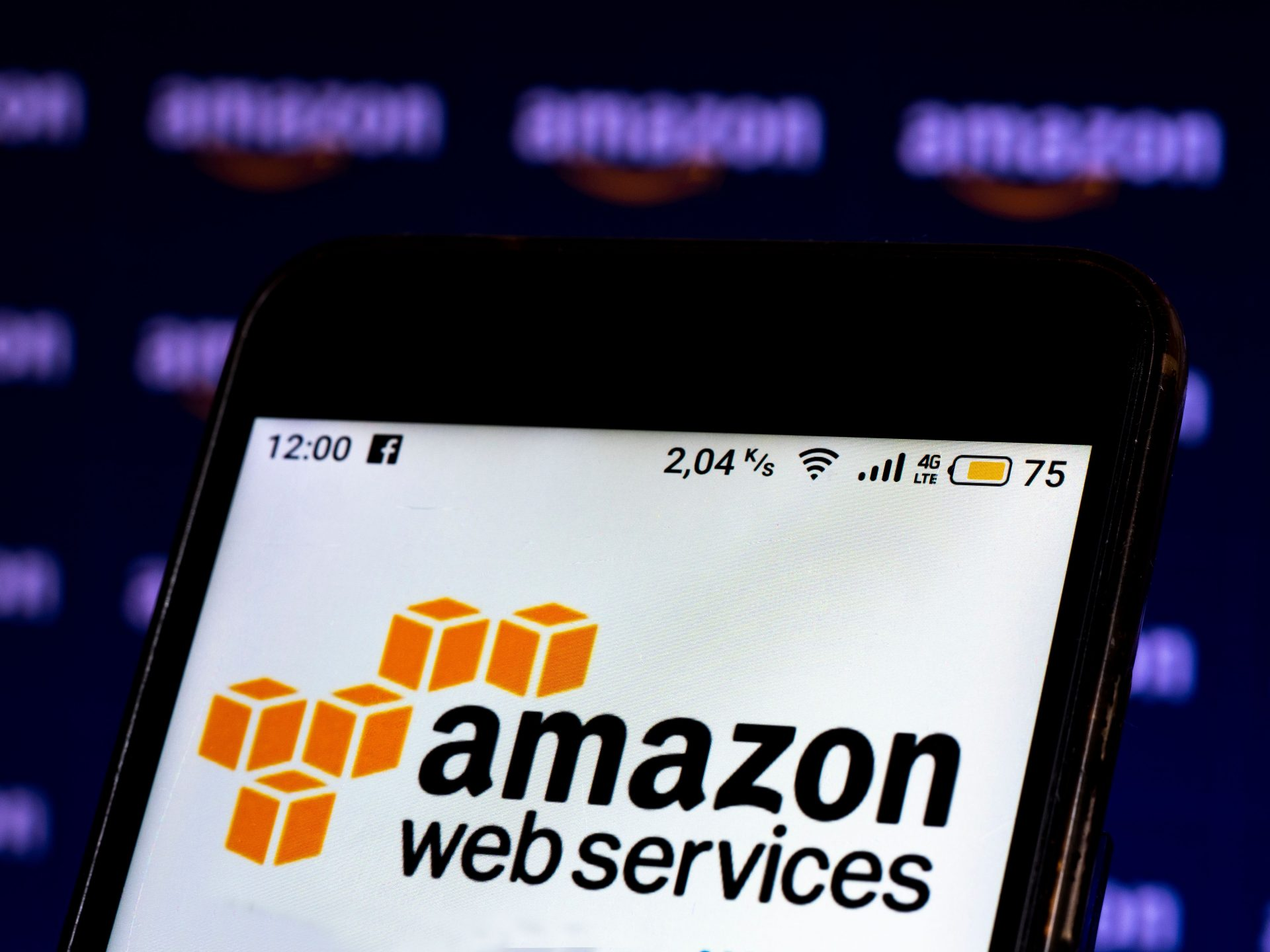 Mandatory Credit: Photo by Igor Golovniov/SOPA Images/Shutterstock (11731989b)In this photo illustration an Amazon Web Services logo seen displayed on a smartphone screen.