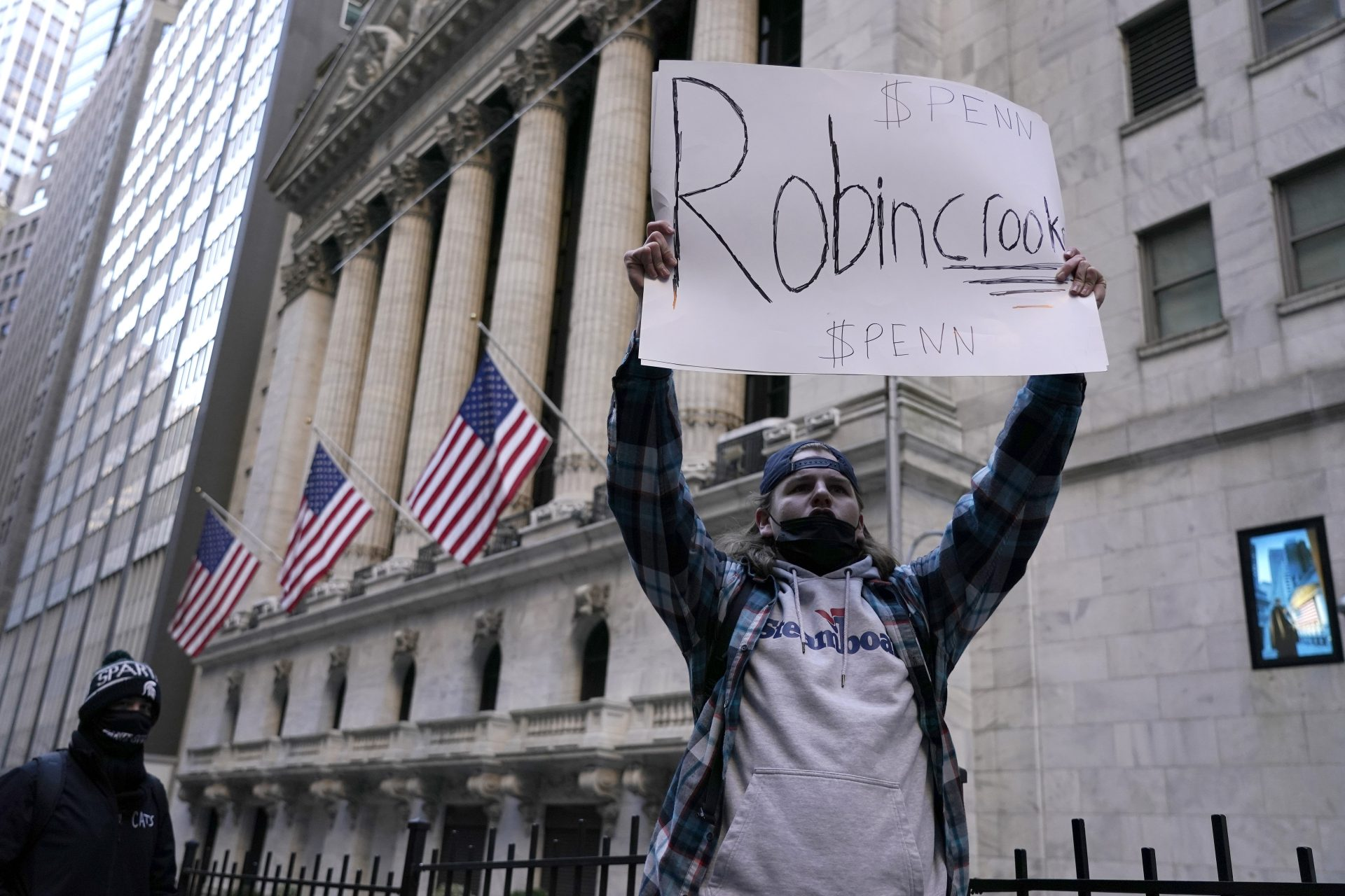 Mandatory Credit: Photo by John Lamparski/SOPA Images/Shutterstock (11734562g)A demonstrator holds up a placard saying Robin Crook in front of the New York Stock Exchange.