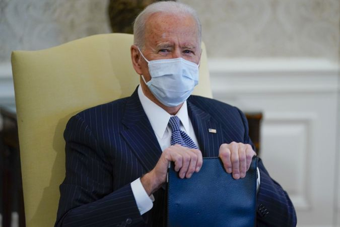 Mandatory Credit: Photo by Evan Vucci/AP/Shutterstock (11745374b)In this, photo, President Joe Biden during his meeting with Democratic lawmakers to discuss a coronavirus relief package, in the Oval Office of the White House in Washington.