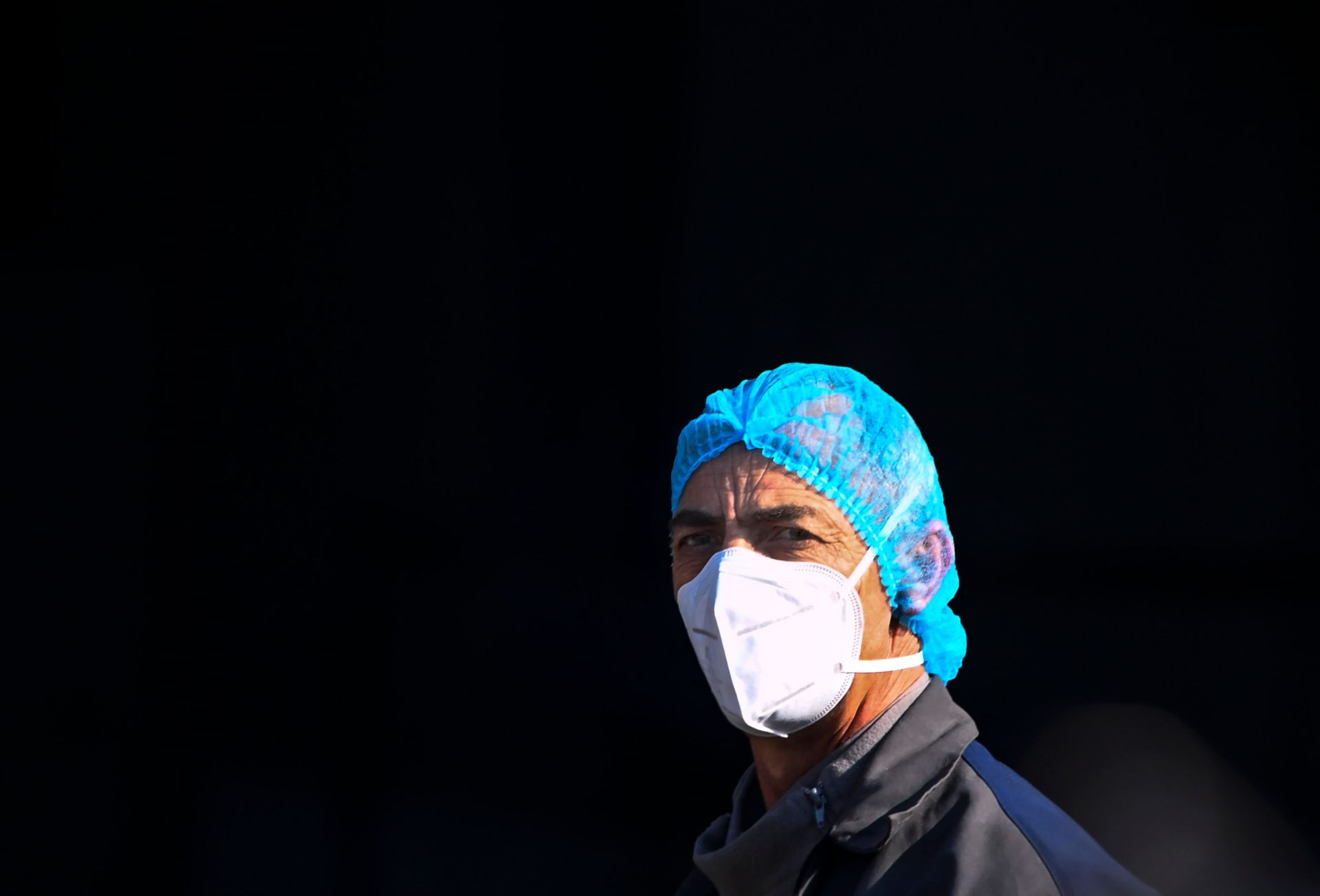 Mandatory Credit: Photo by GEORGI LICOVSKI/EPA-EFE/Shutterstock (11745943a)A woman wearing a protective mask and a hairnet walks in front of the University Clinic for Infectious Diseases in Skopje, Republic of North Macedonia, 04 February 2021.