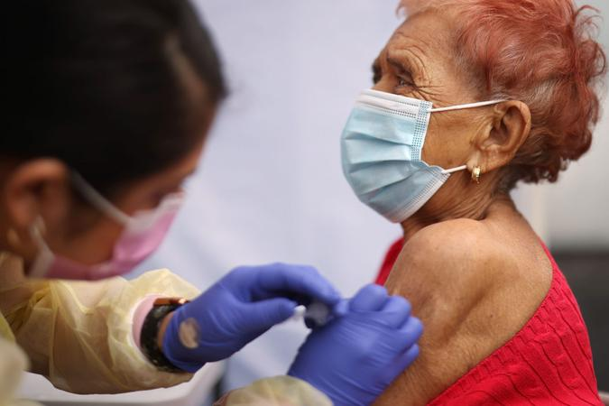 Mandatory Credit: Photo by Dania Maxwell/Los Angeles Times/Shutterstock (11759695k)Evelin Nunez, left, gives Concepcion Ponez the Pfizer vaccine during an event to inoculate about 500 health care workers and adults over the age of 65 against COVID-19 put on by the Labor Community Services, the Los Angeles Federation of Labor and St.