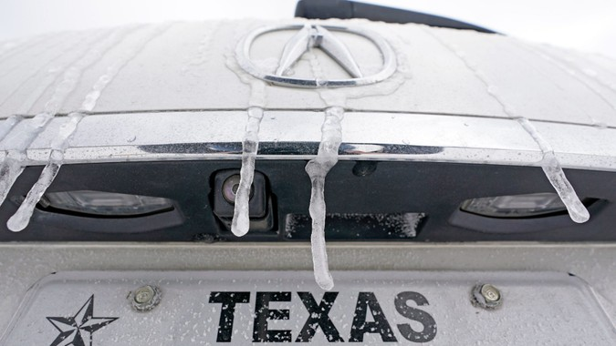 Mandatory Credit: Photo by David J Phillip/AP/Shutterstock (11760600u)Icicles hang on the back of a vehicle, in Houston.